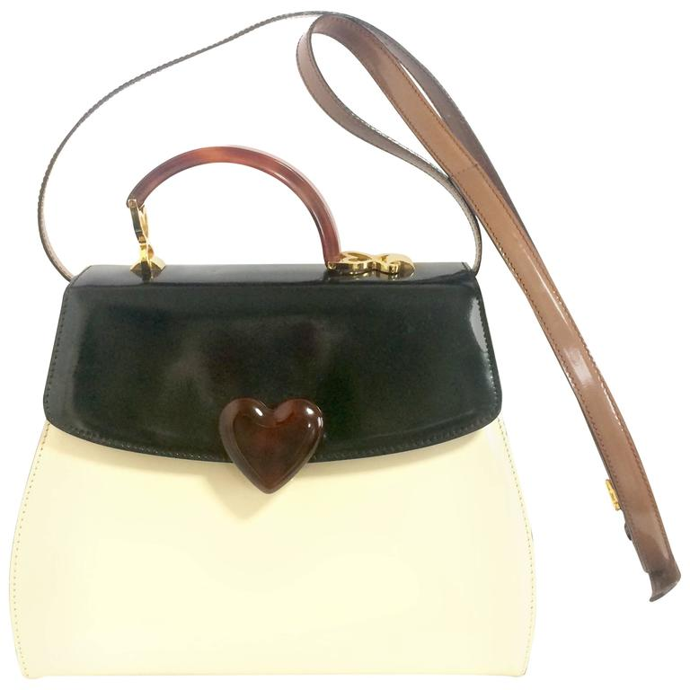 Vintage MOSCHINO white, black, brown patent enamel bag with heart motif. RedWall 1