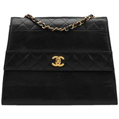 1990s Chanel Black Quilted Lambskin Vintage Trapeze Single Flap Bag