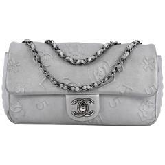 Chanel Precious Symbols Single Flap Bag Embossed Leather Medium