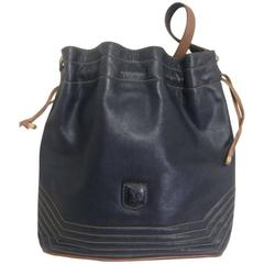 Vintage Celine navy and brown leather hobo bucket shoulder bag with drawstrings.