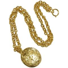 MINT. Vintage CHANEL golden long chain necklace with round coin, medal shape top
