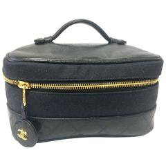 Vintage CHANEL black leather and canvas fabric vanity bag, cosmetic pouch.