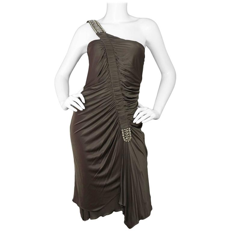 Roberto Cavalli Bronze Ruched One Shoulder Dress  Features embellishments on one shoulder strap  Color: Bronze Composition: Not given- believed to be a nylon/elastane-blend Lining: Bronze Nylon-blend Closure/Opening: Back zip up closure Exterior