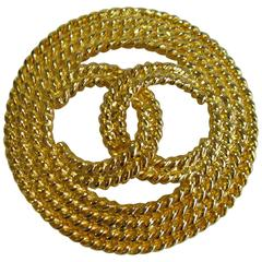 Chanel Vintage Round Brooch in Gilt Metal