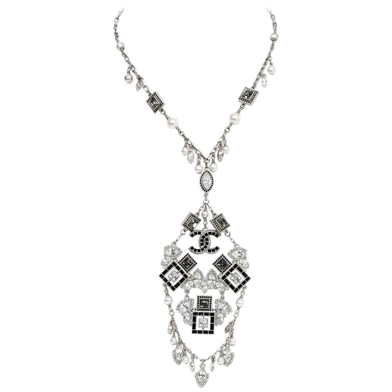 Chanel '15 A/W Runway Crystal Charm Necklace Features smaller faux pearls and crystals hanging off of chain and center dangling CC charm  Made In: Italy Year of Production: 2015 Color: Black, grey, clear and silvertone Materials: Metal and