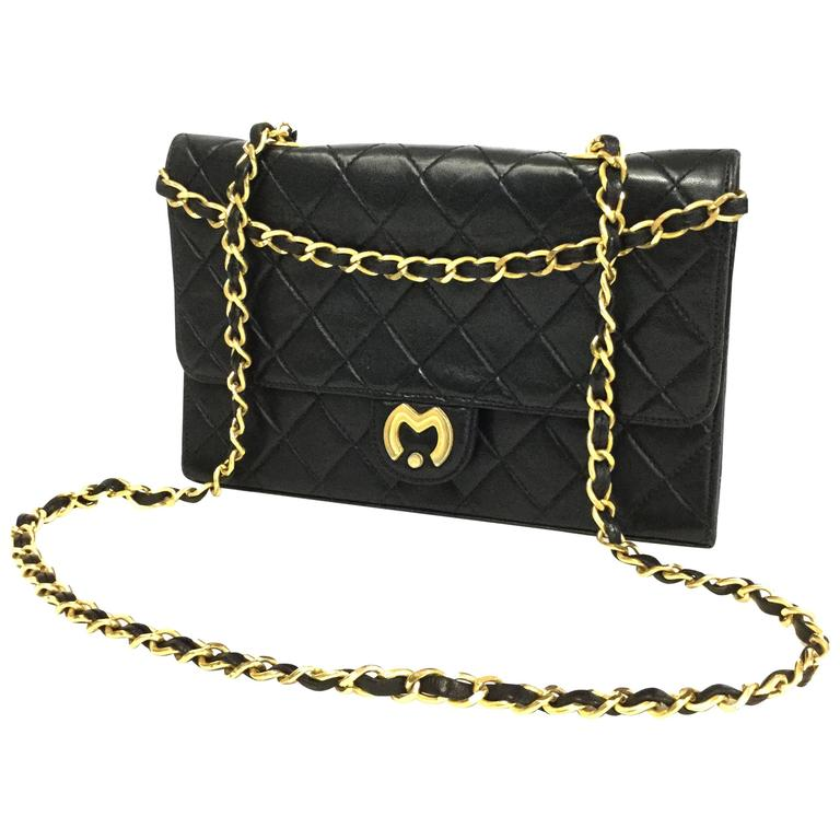 1980s Mila Schon Black Quilted Leather Gold Chain Cross
