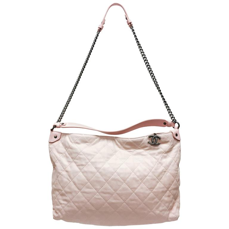 CHANEL Light Pink Quilted Calfskin Leather Coco hobo bag from the 13C collection. Relaxed and versatile design is perfect for casual luxury. This bag features a long ruthenium chain strap for hands-free wear with a leather shoulder strap and a