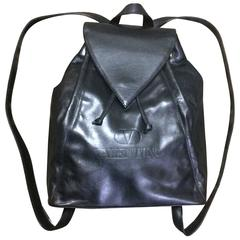 Vintage Valentino black nappa leather backpack with embossed logo. Classic bag.
