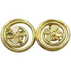 Chanel Vintage Gold Toned Clover Swirled Edge Clip On Logo Earrings