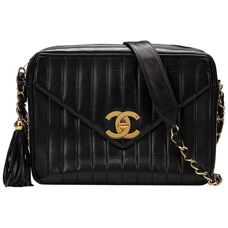 66bc8780 1996 Chanel Black Vertical Quilted Lambskin Vintage Camera Bag