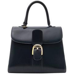 Good vintage condition  Delvaux Blue Brillant MM Bag  The Brillant is one of Del