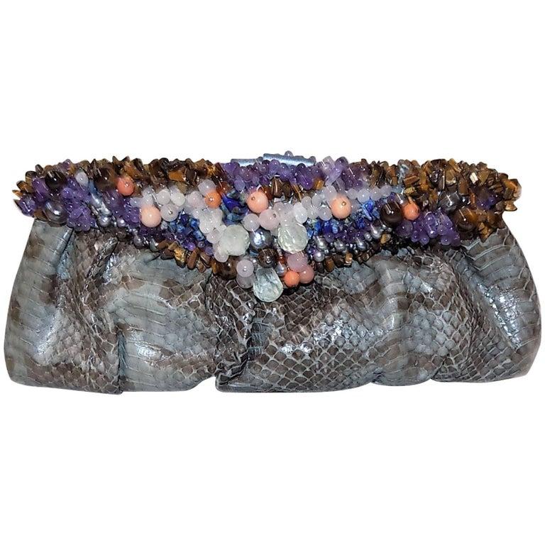Handmade python bag/ clutch  with clustered frame of semi precious stones