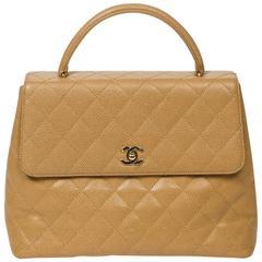 Chanel Kelly Handbag Beige Quilted Caviar