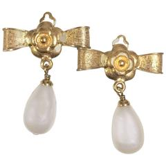 Vintage CHANEL golden bow and camellia motif and dangling white teardrop earring