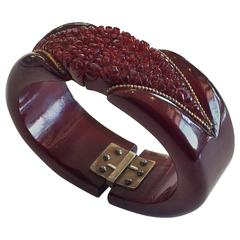 Art Deco Cherry Amber bakelite heavily carved hinged clamper bangle bracelet