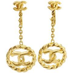 Early 1980s Chanel Gilt Dangling Logo Earrings