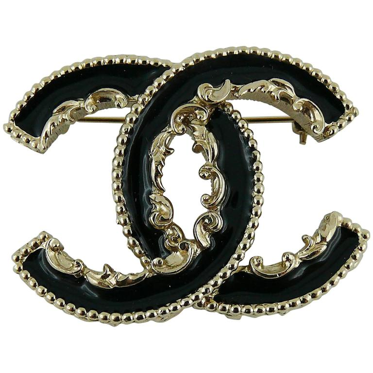 chanel signature accessories date brooch modsie logo metal code cc red jewellery shop