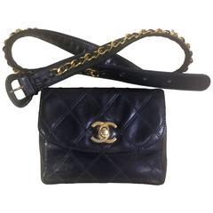 Vintage CHANEL black leather 2.55 waist purse, fanny bag with golden chain belt.