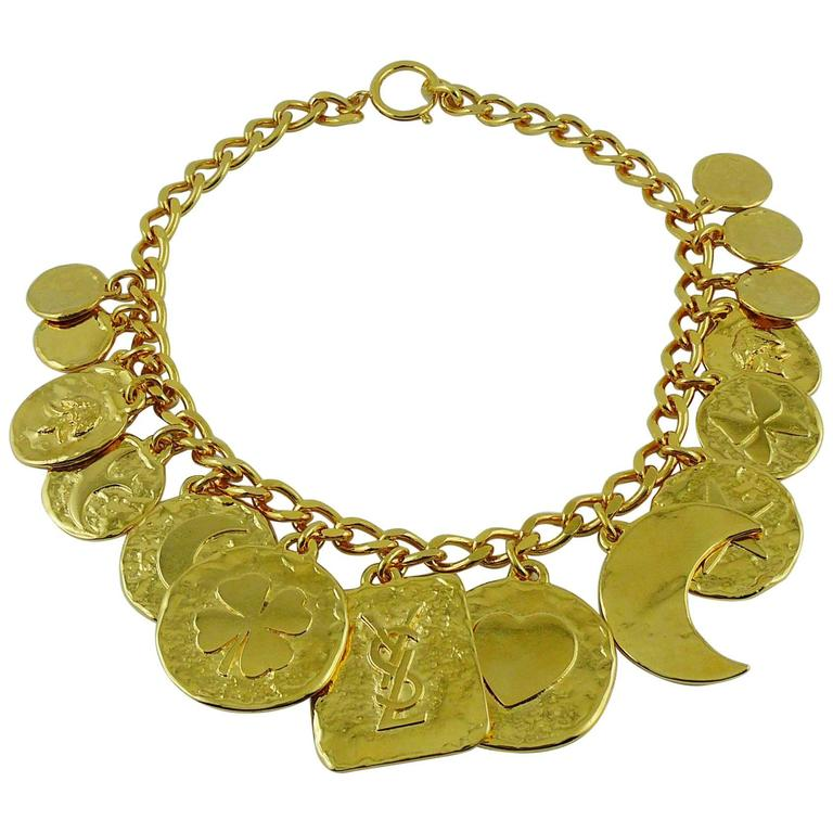 8717e8da25e Yves Saint Laurent Vintage Gold Toned Iconic Multi Charm Necklace For Sale