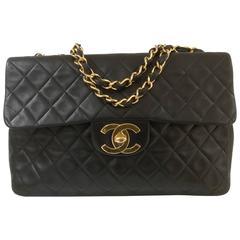 Chanel Black leather gold hardware maxi jumbo shoulder bag