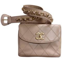MINT. Vintage CHANEL beige waist purse, fanny pack, hip bag with gold CC motif.