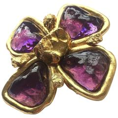 Striking gilt and amethyst 'cruxiform' brooch, Yves Saint Laurent, 1980s
