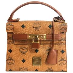 Vintage MCM classic brown mini kelly bag with key, designed by Michael Cromer.