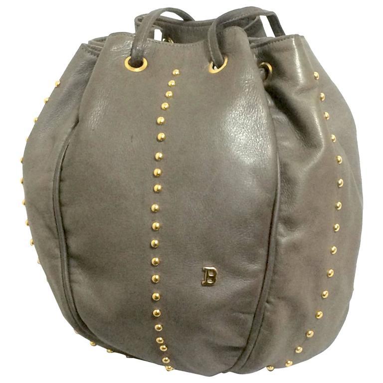 Vintage BALLY gray leather ball shape hobo bucket shoulder bag with studs.