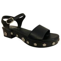Chanel Camellia Sandals in Black with Silver Camellia Flowers on the Platforms