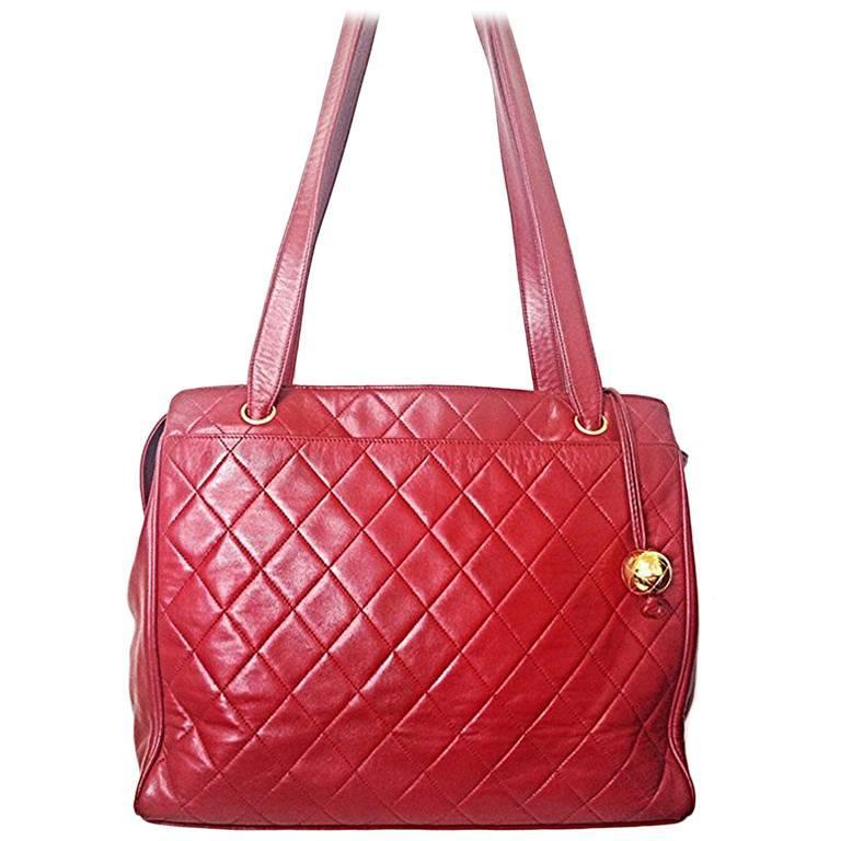 Vintage CHANEL deep red color classic quilted leather tote bag with gold ball.