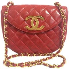 Vintage CHANEL rare red lambskin oval flap 2.55 shoulder bag with large gold CC.