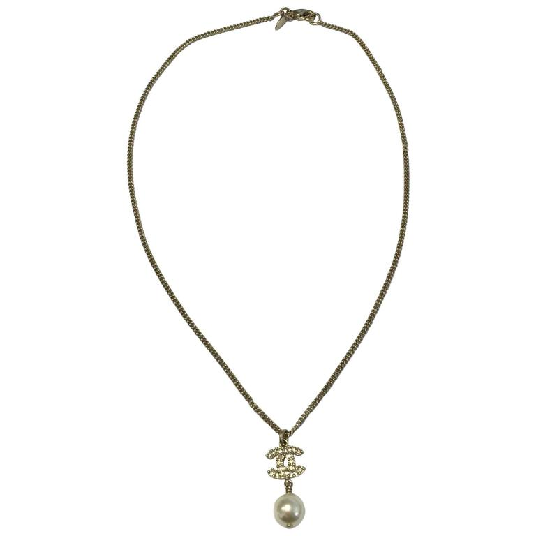 Chanel necklace in gilt metal cc pendant in rhinestones and glass chanel necklace in gilt metal cc pendant in rhinestones and glass pearl for sale aloadofball Images