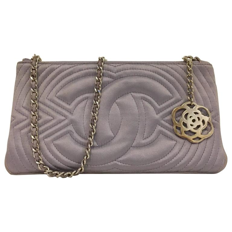 Chanel Small Satin Lavender Clutch with Metal Charm