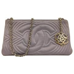 Charming Chanel Small Satin Lavender Clutch with Metal Charm