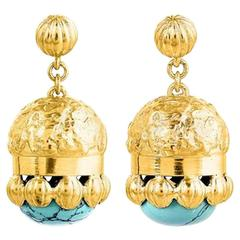 Turquoise gold drop earrings.