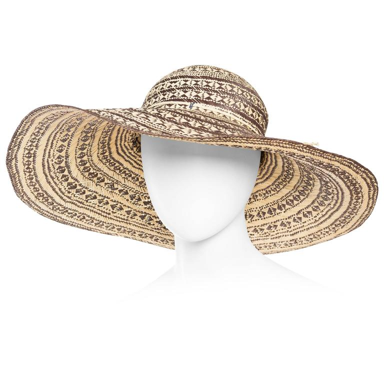 Handwoven Wide Brimmed Straw Picture Hat For Sale