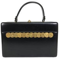 Vintage Prestige gold zodiac coin black box calf handbag 1950s