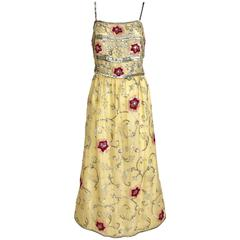 1960s yellow silk gown with red and silver sequin vintage embroidered gown