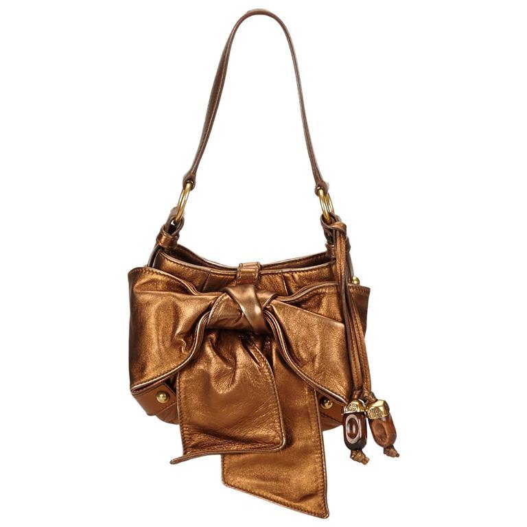 3c151c97405 Yves Saint Laurent YSL Vintage Black Leather Arabesque Handbag.  HomeFashionHandbags and PursesTop Handle Bags. YSL Brown Metallic Leather  Sac Bow For Sale