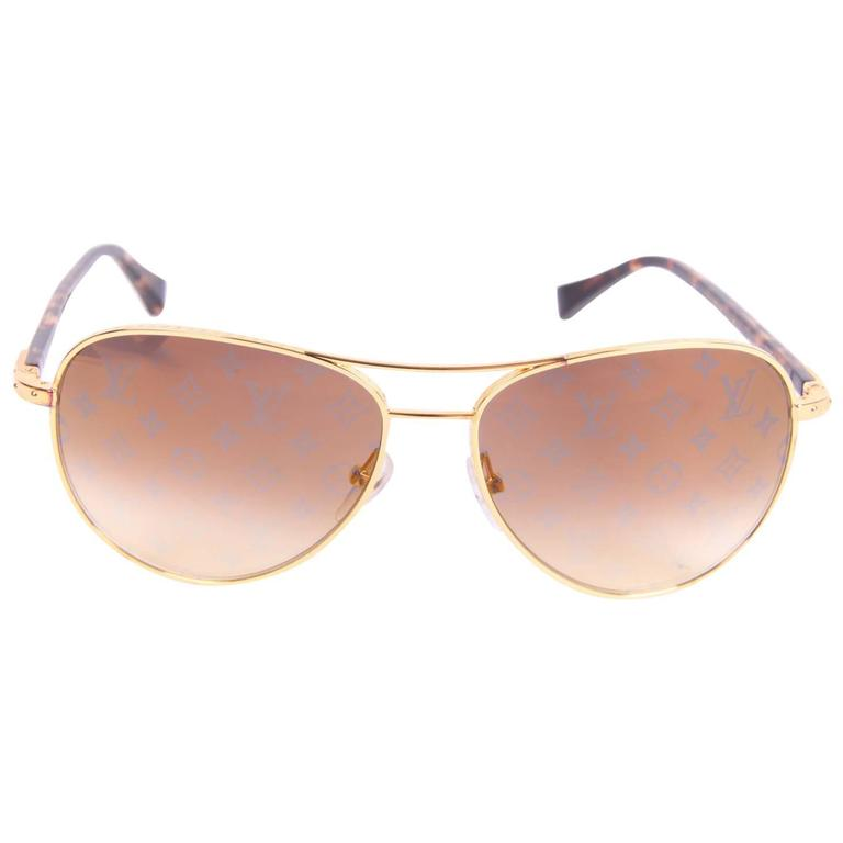 eac469724cfe0 Louis Vuitton Conspiration Pilote Sunglasses - gold brown at 1stdibs