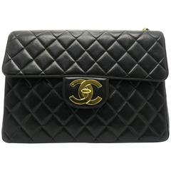 Chanel Black Quilting Lambskin Leather Gold Metal Flap Bag