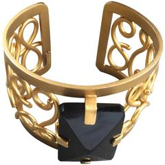 Really Nice Nina Ricci Gold Plated Cuff with central stone
