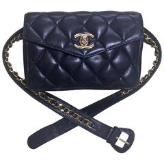 Vintage CHANEL black leather waist bag, fanny pack with golden chain belt & CC.