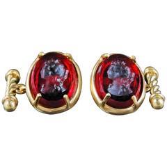 Bronze and engraved red Murano glass cufflinks