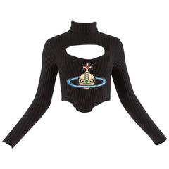 Vivienne Westwood Autumn-Winter 1991 knitted corset with cut out and large orb