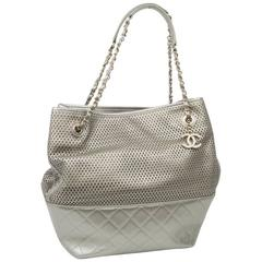 CHANEL Bag in Quilted and Perforated Silver Leather