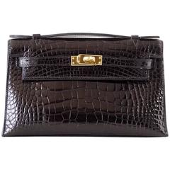 Hermes Kelly Pochette Clutch Bag Shiny Black Alligator Gold