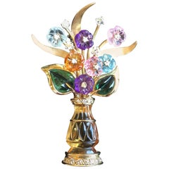 Figural Vase Brooch of Carved Semi-Precious Flowers.