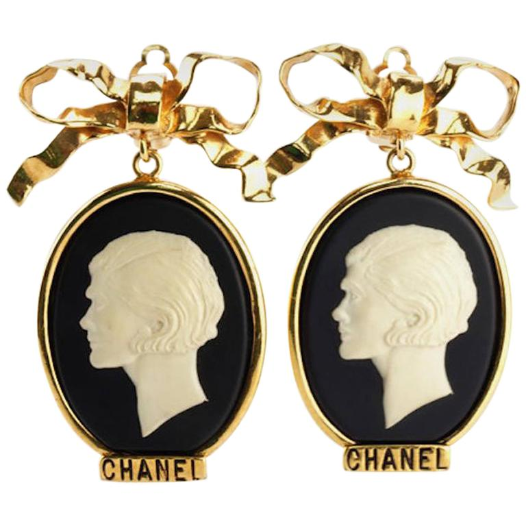 Chanel Gold Plate Bow with Dangle White Statue Clip On Earrings For Sale