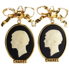Chanel Gold Plate Bow with Dangle White Statue Clip On Earrings